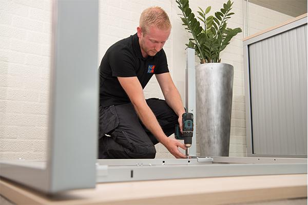 Zoek een leverancier die het eventueel kan inhuizen en monteren bij de werknemers